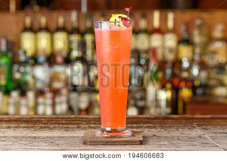 Gorgeous refreshing strawberry cocktail based on gin lemon juice and soda is on the bar space for text