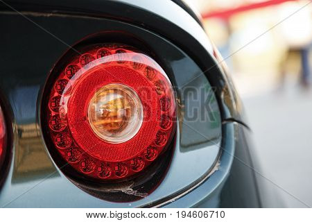 Red round back lights on a black car