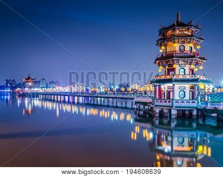 Beautiful light decorative pagoda at lotus pond in Kaohsiung city of Taiwan on important celebration day at night blue twilight time