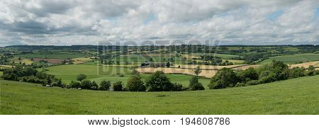 Panorama of green fields in the english midlands cotswolds landscape