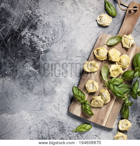 Top view on homemade pasta ravioli on old  table