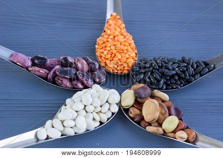 Yellow Lentils, Black, White, Brown, Purple Beans On Blue Wood