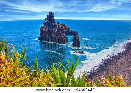 Aerial view of Madeira Island in the Atlantic Ocean. Impressive trip to the fairy island. Three huge scenic rocks. Concept of exotic and ecological tourism