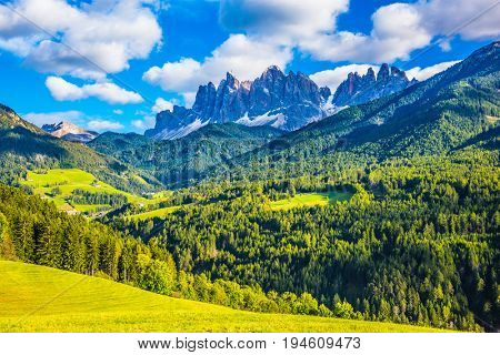 Warm autumn in  the Val de Funes, Dolomites. The concept of ecological tourism. The valley in Tirol is surrounded by a dentate wall of dolomite rocks