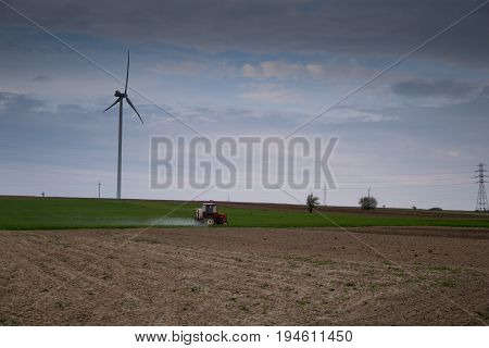 Old Tractor Spraying Pesticides