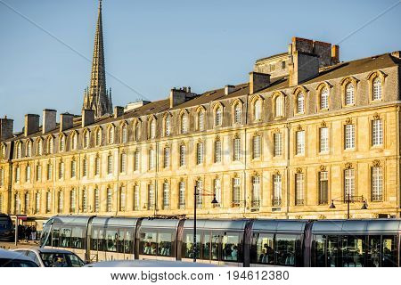 Seaside view on the beautful buildings and tower of saint Michel cathedral during the morning light in Bordeaux city, France