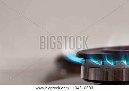 Close Up Of Gas Burner On Stove On Background With Copyspace.