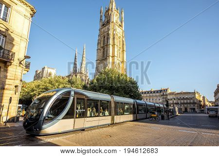 Morning view on the square with saint Pierre cathedral tower in Bordeaux city, France