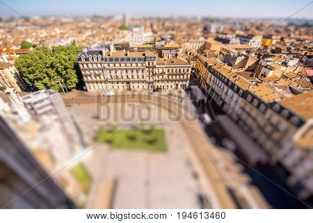 Aerial cityscape view on the old town of Bordeaux city during the sunny day in France. Tilt-shift image technic