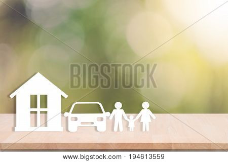 home car family on wood table. concept assurance health-care insurance.