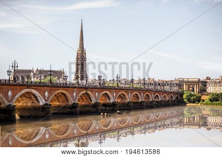 View on the famous saint Pierre bridge with saint Michael cathedral in Bordeaux city, France