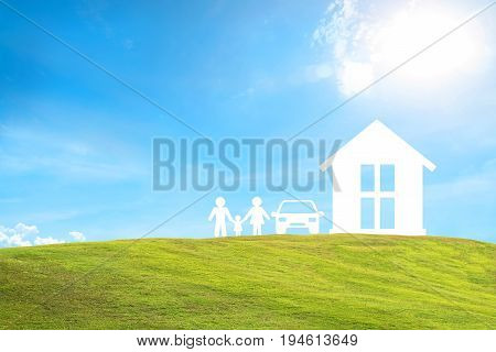 home car family on green grass and blue sky. concept assurance health-care insurance.