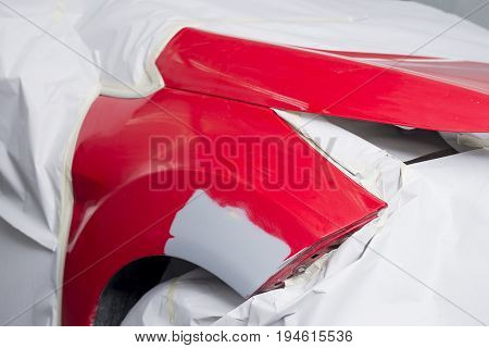Auto body repair series: Red car after being masked waiting for repaint