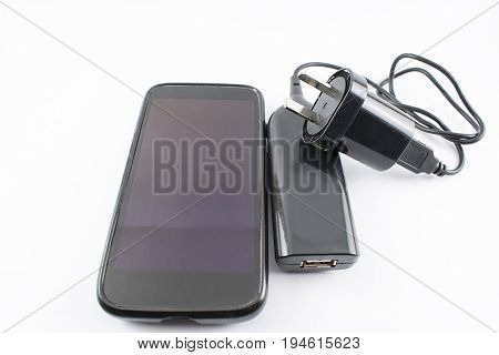 Cell phone with a portable charger and wall charger.