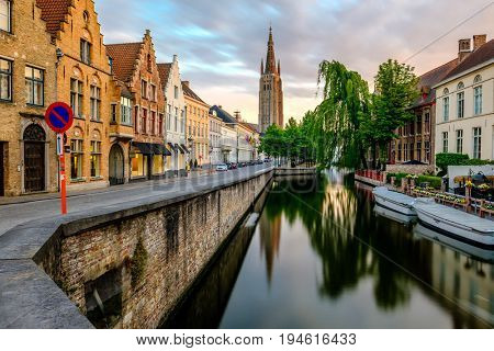 Bruges (Brugge) cityscape with water canal and Church of Our Lady, Flanders, Belgium
