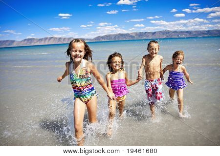 Children having Playing at the Beach