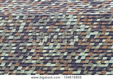 Colored roofing of roof tiles on the roof of a residential building