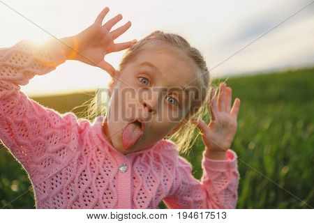 Little cheery girl on open air. Girl six years.