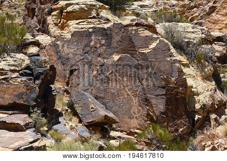 PAROWAN, UTAH - JUNE 29, 2017: Parowan Gap petroglyphs. At the edge of the dry Little Salt Lake, lies a natural gap in the mountains, covered with hundreds of petroglyphs and dinosaur tracks.