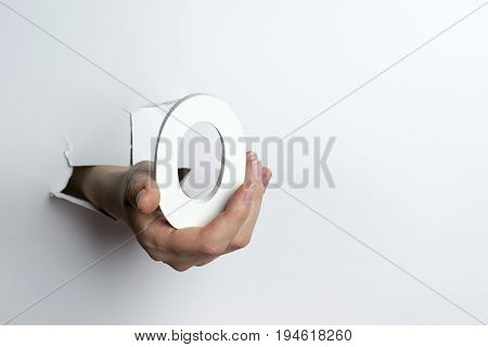 Female Hand Holding A Number Zero A White Background.