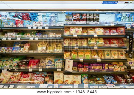 SEOUL, SOUTH KOREA - CIRCA MAY, 2017: cheese on display at Lotte Mart in Seoul. Lotte Mart is an east Asian hypermarket that sells a variety of groceries, clothing, toys, electronics, and other goods.