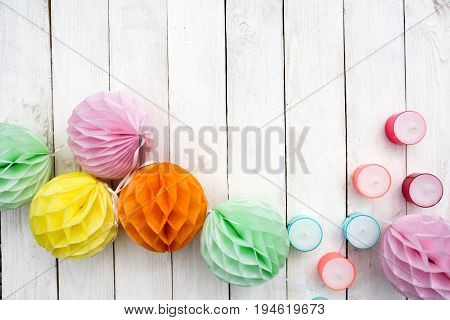 Background decoration with colorful objects for a summer party on white wood in vintage style