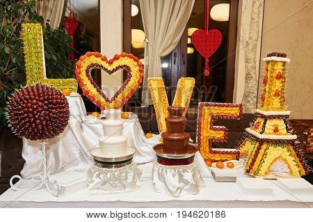 Black and white chocolate fountains on the table at the restaurant celebrating love happiness delicious eating dessert sweet.