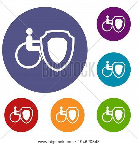 Wheelchair and safety shield icons set in flat circle reb, blue and green color for web
