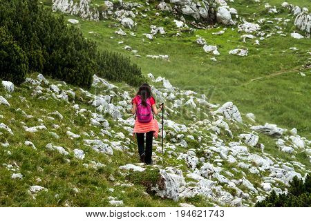 female hiker on her way up to the top of mountain
