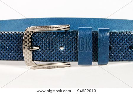Part of blue leather belt with metal buckle.White isolated background.Accessories.