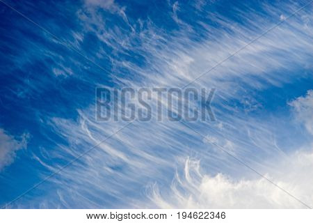 Sky with unusual pattern of spindrift clouds. Diagonal background