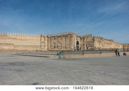 Fez, Morocco - May 9, 2017: Old medina wall and gate in Fez. Boujloud square Marocco