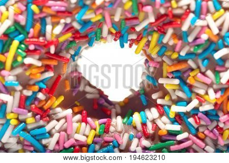 Rainbow sprinkles on doughnut, close-up