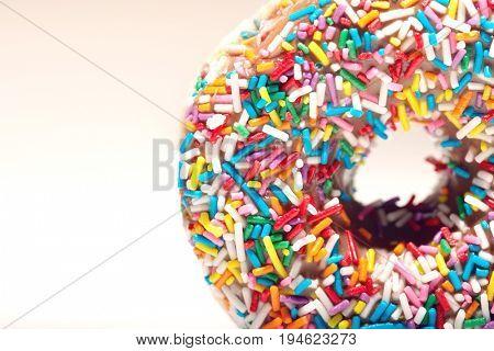 Rainbow sprinkles on doughnut