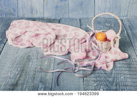 Yarn balls in basket. Knitwork background. Art craft, hand made. Handiwork, sewing and needlework.