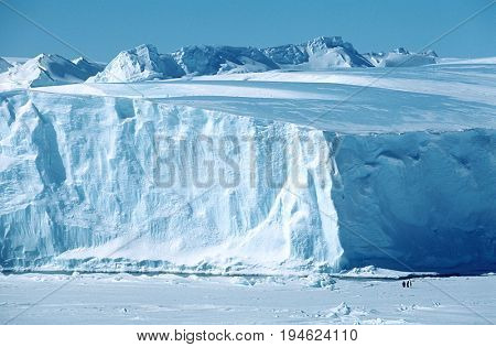 Antarctica, Weddell Sea, Riiser Larsen Ice Shelf, Iceberg with Emperor Penguins