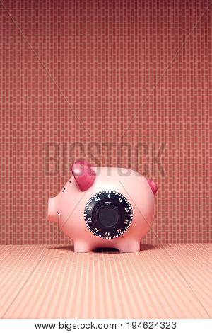 Piggy bank with combination lock, side view