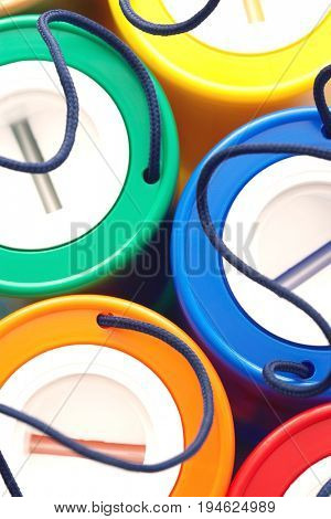 Colorful plastic money boxes, view from above