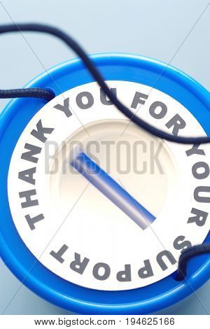 Blue plastic money box, view from above