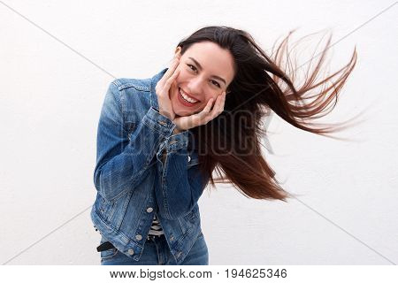 Cute Woman In Denim Jacket With Long Hair Blowing