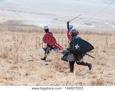 Tiberias Israel July 01 2017 : Participants in the reconstruction of Horns of Hattin battle in 1187 Dressed in the costumes of the crusaders are running into the attack near Tiberias Israel