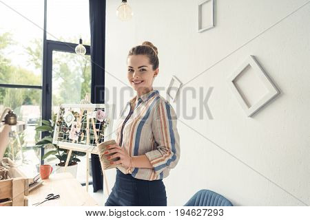 Happy Creative Attractive Female Florist With Twine At Workplace