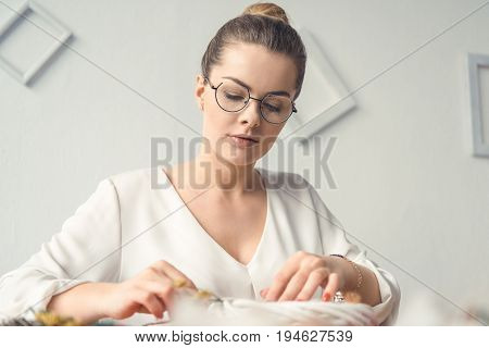 Creative Beautiful Female Decorator With White Wreath At Workplace