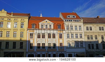 Houses front in an Saxon old town, renovated facades, tile roofs, historic town houses with ornaments, blue sky