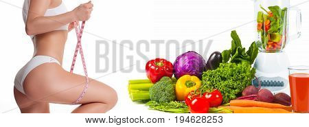 Woman Measuring Her Body With A Measure Tape. Diet Concept, Fresh Vegetables