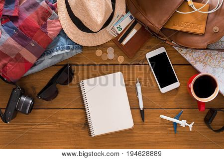 Travel planning concept top view. Vacation planning on rustic wooden background, search for best trip, copy space for text