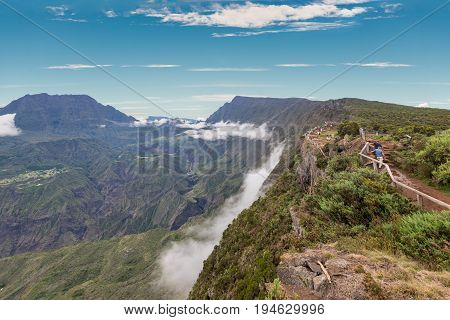 Piton Maido La Reunion Island France - December 24 2015: Tourists on the Maido lookout overlooking Cirque of Mafate listed as World Heritage by UNESCO La Reunion Island France.