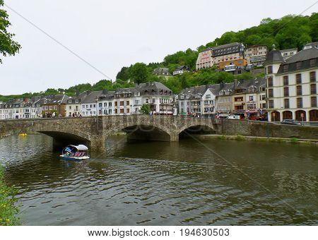 The old stone bridge over Semois river in the heart of Bouillon, Belgium