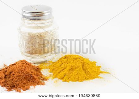 Condiments such as saffron paprika and pepper.About a white background.