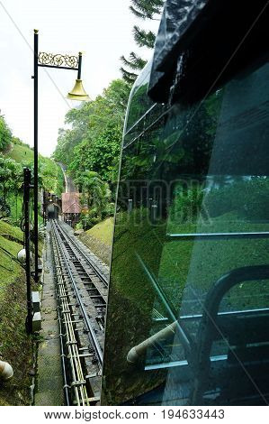 View of a tram tracks at Penang Hill Malaysia. A favourite tourism spot among locals and foreign tourists.